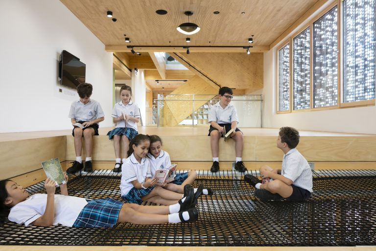 The school library features a suspended reading pit
